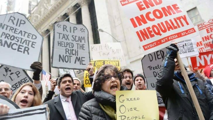 Demonstrators protest the GOP tax plan at the New York Stock Exchange